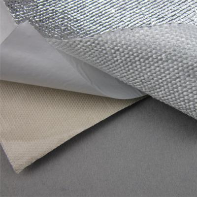 Heat shield barrier with adhesive